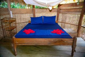 A bed or beds in a room at Kactus