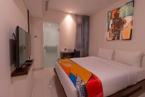 A bed or beds in a room at Grand Picasso Hotel