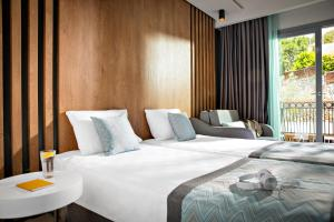 A bed or beds in a room at TUI MAGIC LIFE Bodrum