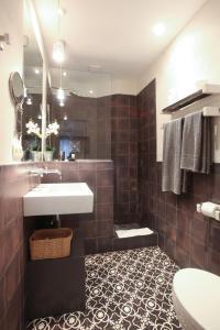 ห้องน้ำของ Apartamentos Caravane