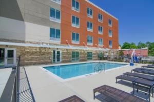 The swimming pool at or near Holiday Inn Express & Suites Mobile - University Area, an IHG Hotel