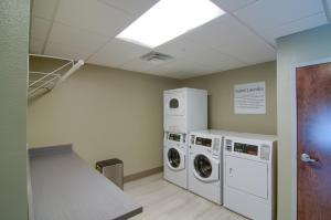 A kitchen or kitchenette at Holiday Inn Express & Suites Mobile - University Area, an IHG Hotel