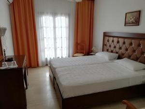 Letto o letti in una camera di Hotel Paradise