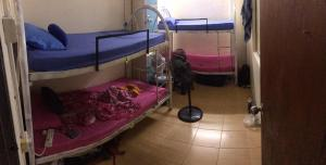 A bunk bed or bunk beds in a room at Sweet Monkey Backpacker Hostel