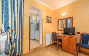 TV o dispositivi per l'intrattenimento presso Apartments and Rooms Laura