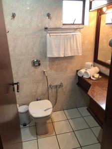 A bathroom at Hotel Residencial Itapema