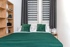 Postel nebo postele na pokoji v ubytování 3D KOSCIUSZKI 19 Apartament