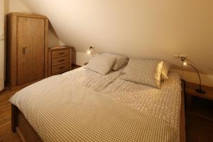 Кровать или кровати в номере Panonska Vas Villas