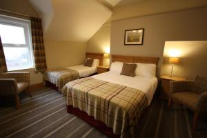 A bed or beds in a room at The Coledale Inn