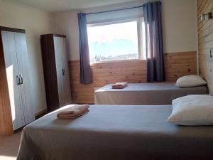 Cama o camas de una habitación en PAMPA HOSTEL