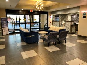 The lobby or reception area at SureStay Plus Hotel by Best Western Coralville Iowa City