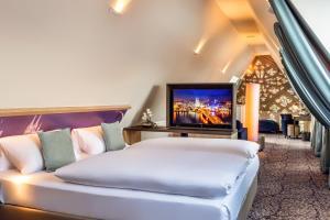 Ein Bett oder Betten in einem Zimmer der Unterkunft CityClass Hotel Residence am Dom