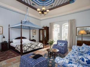 A bed or beds in a room at The American Colony Hotel - Small Luxury Hotels of the World