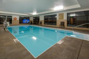 The swimming pool at or near Candlewood Suites Bloomington, an IHG Hotel