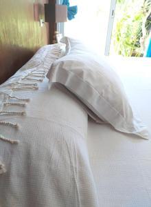 Cama ou camas em um quarto em Matira house