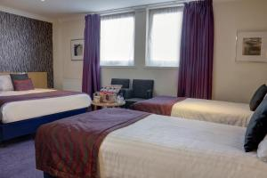A bed or beds in a room at Sure Hotel by Best Western Aberdeen