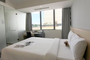 Ein Bett oder Betten in einem Zimmer der Unterkunft Pacific Express Hotel Central Market Kuala Lumpur