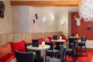 A restaurant or other place to eat at SOWELL HOTELS Parc Hotel