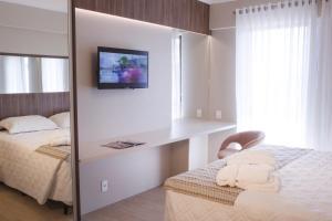 Cama ou camas em um quarto em Aquarius Hotel Flat Residence