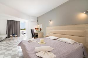 A bed or beds in a room at Sabina Hotel