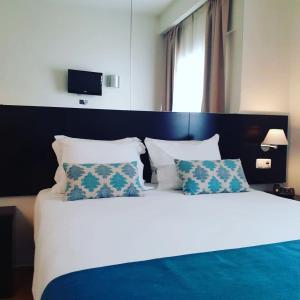 Cama o camas de una habitación en Lisbon City Hotel by City Hotels