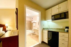 A kitchen or kitchenette at Quality Inn & Suites Evergreen Hotel