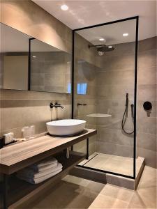 Een badkamer bij Boutique Hotel 'Hof ter Duinen'