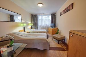 A bed or beds in a room at OW Mikomania