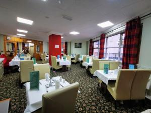 A restaurant or other place to eat at Castle Hotel