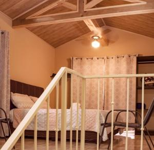A bunk bed or bunk beds in a room at Villas Orosi Valley