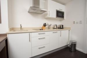 A kitchen or kitchenette at Staybridge Suites Birmingham, an IHG Hotel
