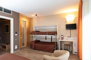 A bunk bed or bunk beds in a room at Hotel Donatello Imola