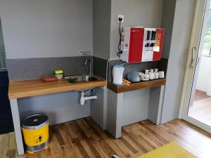 A kitchen or kitchenette at QING YUN BACKPACKER LODGE