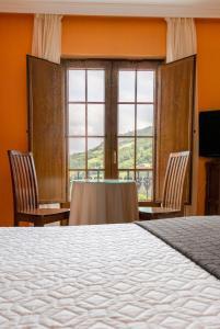 Cama o camas de una habitación en Hotel Rural Casa Paulino