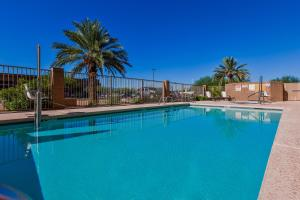 The swimming pool at or near Candlewood Suites Tucson, an IHG Hotel