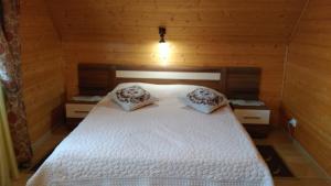 Кровать или кровати в номере Гостевой дом У Кремля