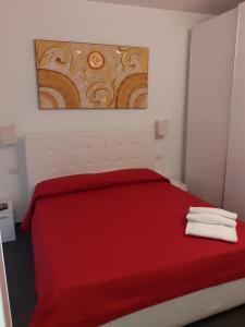 Letto o letti in una camera di Residence Villa Gori