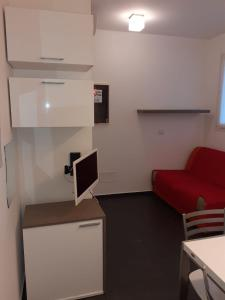 TV o dispositivi per l'intrattenimento presso Residence Villa Gori