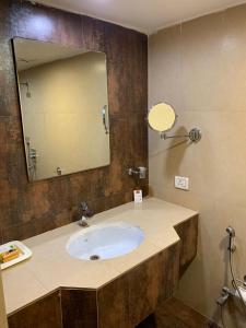 A bathroom at Mourya Lords Inn Kurnool