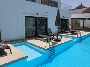 The swimming pool at or near Kalimba Beach Resort