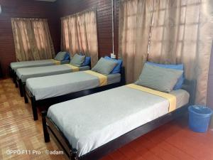 A bed or beds in a room at Senja Bay Resort
