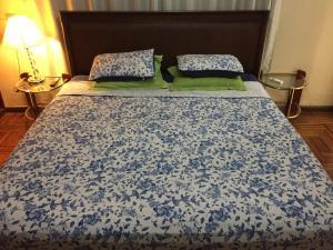 A bed or beds in a room at Casa Flor de Lis