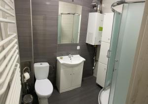 A bathroom at Apartament Aleksandra