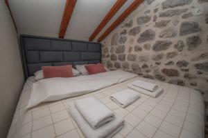 Ein Bett oder Betten in einem Zimmer der Unterkunft Antika Guesthouse