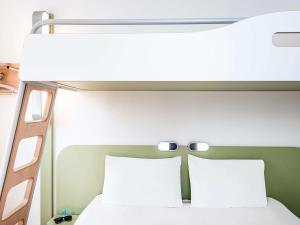 Un ou plusieurs lits dans un hébergement de l'établissement ibis budget Orly Rungis
