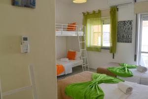 A bunk bed or bunk beds in a room at Alvor House Lagoon