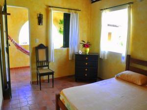 Katil atau katil-katil dalam bilik di Pousada Chez Roni