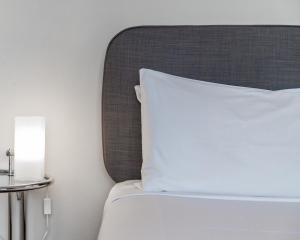 A bed or beds in a room at Dive Hotel