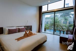 Ein Bett oder Betten in einem Zimmer der Unterkunft Bundhaya Resort