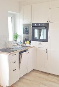A kitchen or kitchenette at Sopot Apartament